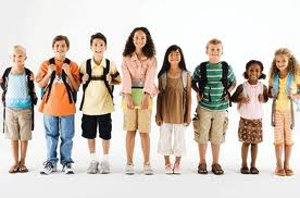 School Kids standing in a line, some with backpacks on